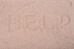 The inscription on the sand Help, close-up. The inscription on the sand Help,  close-up Stock Images