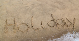 Inscription on the sand - holiday Royalty Free Stock Photography
