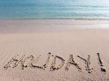 Inscription on sand- holiday Stock Photos