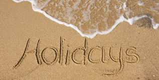 The inscription on the sand - holidays Stock Image