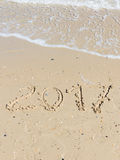 2017 inscription on the sand