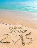 2015 inscription on the sand near the sea. Royalty Free Stock Photos