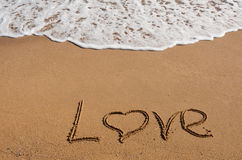 The inscription on the sand near the sea - love Royalty Free Stock Photo