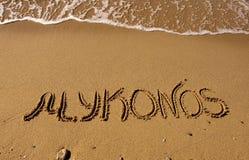 The inscription on the sand near the sea - Mykonos Royalty Free Stock Photo