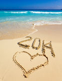 2014 inscription on the sand near the sea.Sea tropical landscape in a sunny day Stock Photos