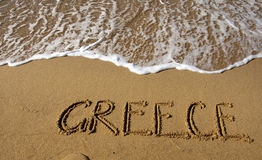 The inscription on the sand by the sea - Greece. Stock Photos