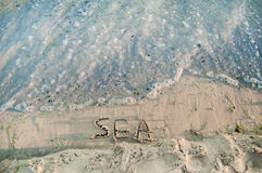 Inscription on the sand - Sea near the black sea. Stock Photos