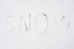 Inscription snow on snow-covered ice Royalty Free Stock Photo