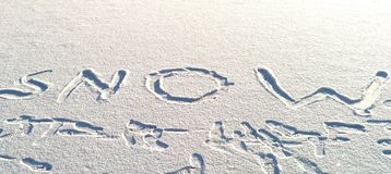 Inscription on snow - snow Stock Photography