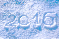 2016 inscription. On the snow winter background Stock Image