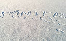 Inscription on snow - winter Stock Photos