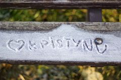 Inscription on a snowy bench Royalty Free Stock Image