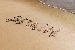 Inscription Spain on the sand beach Royalty Free Stock Photos