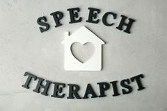 Inscription SPEECH THERAPIST made. With  letters on texture background Royalty Free Stock Photo