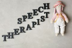 Inscription Speech Therapist made with. Letters on texture background Royalty Free Stock Image