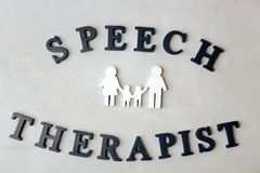 Inscription SPEECH THERAPIST made with  letters. On texture background Stock Image
