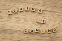 Inscription / Spring is coming / arranged from blocks strung on a string. View of the inscription / Spring is coming / arranged from blocks strung on a string Stock Photography