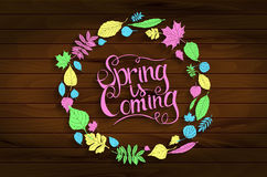 Inscription Spring is coming on wooden background. In a frame of colored leaves. Hand draw, vector illustration. Graphic design Royalty Free Stock Photography