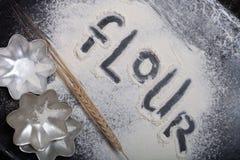 Inscription on sprinkle flour on black background Royalty Free Stock Photo