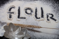 Inscription on sprinkle flour on black background Stock Photo