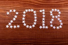 the inscription 2018 stars on wooden background, Christmas, new year, two thousand eighteen Royalty Free Stock Photography