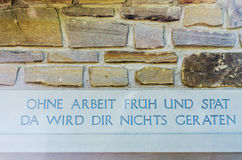 Inscription in stone. Inscription over entrance with a wise saying Royalty Free Stock Images