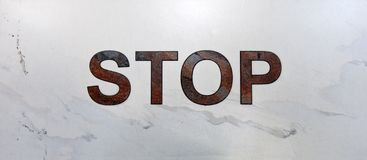 Inscription stop on light marble Royalty Free Stock Photo