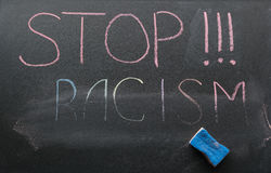 Inscription of stop racism stock photography