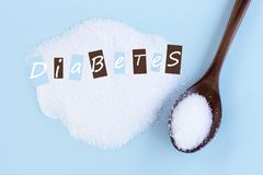 Inscription on sugar Diabetes, close-up, blue background, medical concept, Diabetes concept royalty free stock photos