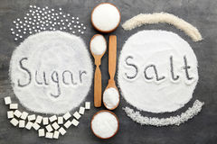 Inscription Sugar and Salt. On grey wooden table Royalty Free Stock Photos