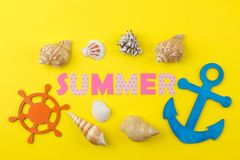 Inscription summer from paper of multi-colored letters and seashells on a bright yellow background. Summer. relaxation. vacation stock images