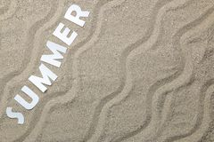 Inscription summer of paper white letters on sea sand. Summer. relaxation. vacation. view from above royalty free stock photos