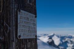Inscription on a summit cross in the mountains, Kleinwalsertal, Austria Royalty Free Stock Photo