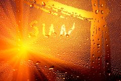 Inscription sun. On water bulbs on a window royalty free stock photography