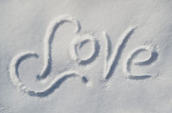 Inscription sur l'AMOUR de neige Image stock