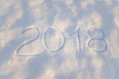 Inscription 2018 sur la surface de neige Photographie stock libre de droits