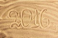 inscription 2016 sur le sable Photographie stock