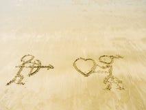 Inscription sur le sable dans la plage de mer Image stock