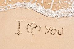 Inscription sur le sable je t'aime Images libres de droits