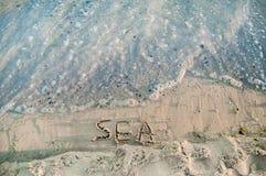 Inscription sur le sable - mer près de la Mer Noire Photos stock