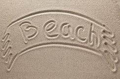 Inscription sur le sable propre de rivière Photographie stock