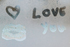 Inscription sur le verre en sueur Image stock