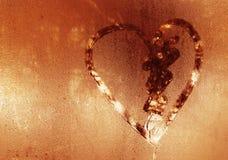 Inscription sur le verre en sueur - amour et coeur Photo libre de droits