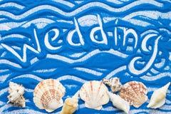 Inscription sur un sable coloré Photographie stock libre de droits