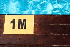 Inscription of the swimming pool depth of 1 meter Stock Image