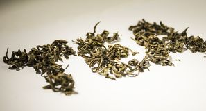 Inscription tea from green tea leaves on a white background.  royalty free stock photos