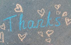 The inscription thank you in chalk on the pavement. Selective focus
