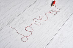 the inscription of the thread - love stock images