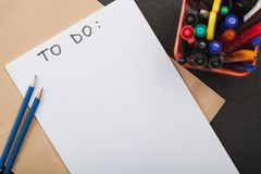 Inscription to do on white sheet of paper and pencils Stock Photo
