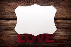 Inscription vide de label et d'amour sur le fond en bois Images stock